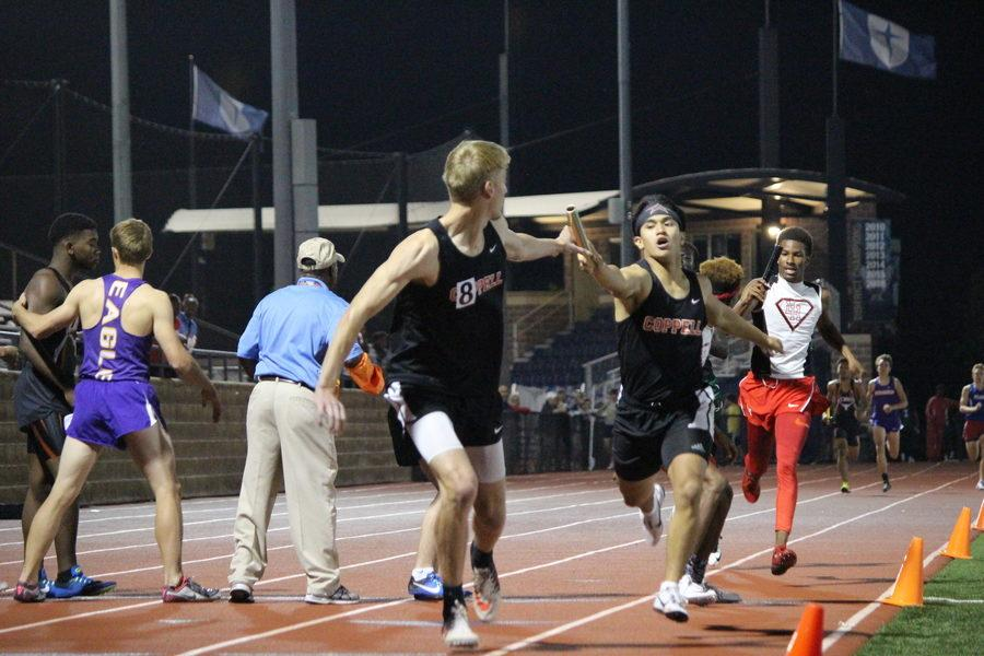 Coppell+High+School+senior+Matt+Dorrity+passes+the+baton+to+senior+Zach+Dicken+in+the+Men%E2%80%99s+4x400+Relay+Finals+of+the+UIL+District+9-6A+Track+%26+Field+Championships+hosted+by+Jesuit+Dallas+at+Postell+Stadium+on+Tuesday+night.+The+Coppell+team+consisted+of+sophomore+Christian+Leffingwell%2C+junior+Gabriel+Lemons%2C+senior+Matthew+Dorrity+and+Dicken.+The+team+placed+second+in+the+event%2C+after+Dallas+Skyline%2C+with+a+time+of+3%3A24.37.