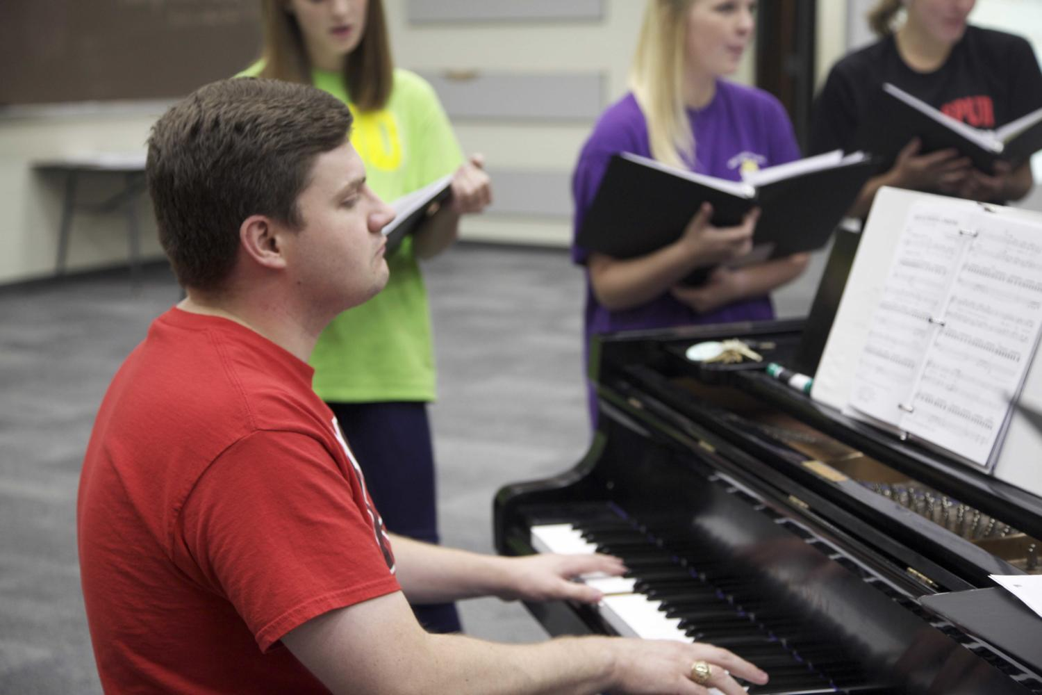 Choir director Josh Brown plays the piano at an after-school a cappella rehearsal at the start of the 2012-2013 school year. Since then, Brown has lead the choir program to numerous awards and national competitions. Sidekick file photo.