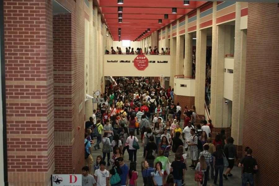 Overcrowding proves to be an issue at Coppell High School as students make their way to classes during passing period.