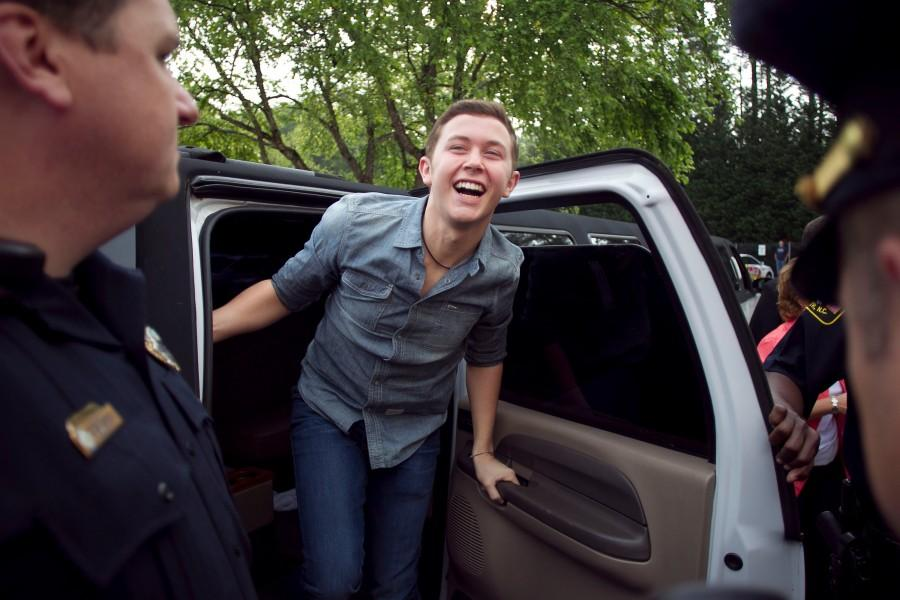 American Idol finalist Scotty McCreery emerges from his limousine at the WQDR studios early on Saturday morning May 14, 2011, his first of many stops during a whirlwind tour of Raleigh and Garner. (Robert Willett/Raleigh News & Observer/MCT)