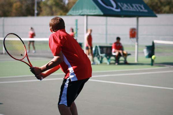 Senior Austin Jennings and fellow tennis members practice at the tennis center at Coppell High School. The tennis center is open every day for students to use. Photo by Brian Hwu.