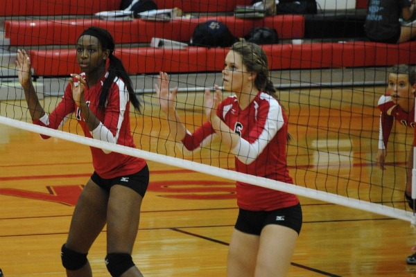 Juniors Chiaka Ogbogu and Cassidy Pickrell focus as they wait for the next play. Photo by Rachel Bush.