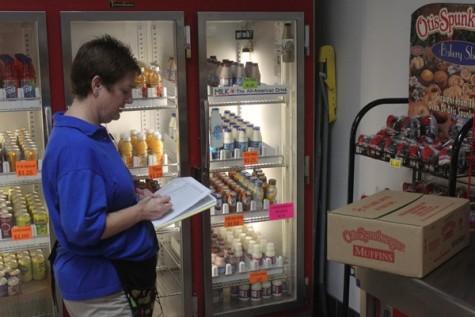 Cafeteria manager, Gena Honza goes through a run down of supplies in the CHS school store.