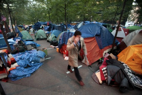 A man heads to work through the Occupy Wall Street camp in Zuccotti Park in New York City, Friday, October 28, 2011. As tempretures drop, some protesters at Occupy Wall Street attempt to stay warm inside tents. (Carolyn Cole/Los Angeles Times/MCT)
