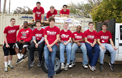 The varsity basketball team took of Saturday practice to help out those in need.