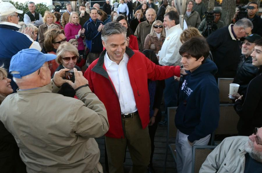 Republican Presidential candidate Jon Huntsman greets the crowd as he arrives at the Skull Creek Boathouse on South Carolina's Hilton Head Island on Saturday, January 14, 2012. (Jonathan Dyer/The Island Packet/MCT)