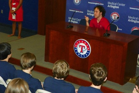 A Texas Ranger's reporter talks to the EMAC Academy students in the press conference room about his job and internships with the Texas Rangers. Photo by Trevor Stiff.