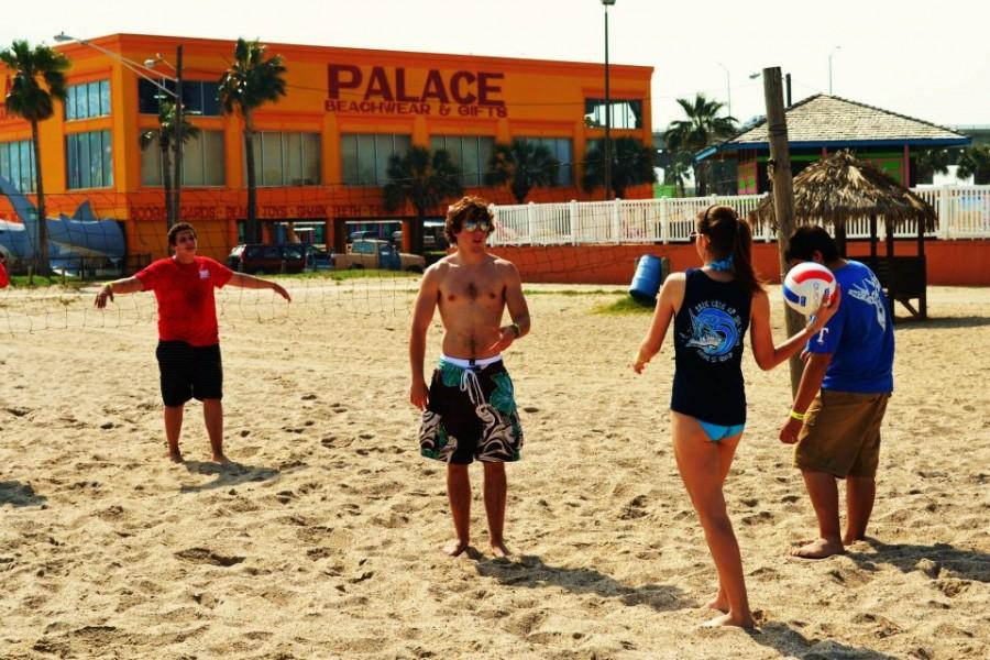 (L-R) Junior Matt Trovalli, seniors Alex Cleveland and Snezana Bijelic, and junior Dale Wood play sand volleyball on the beach. Photo courtesy of Hannah Rucker.