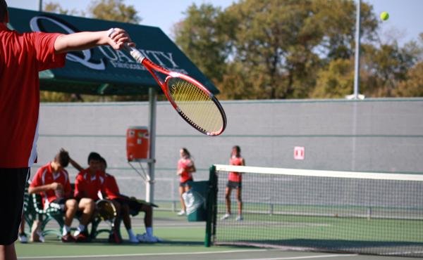 Senior tennis player continues sport through coaching