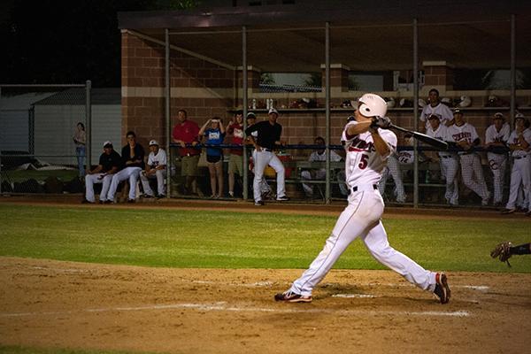 Clayton Dalrymple gets a hit in a regular season win against Keller. Photo by Brian Hwu