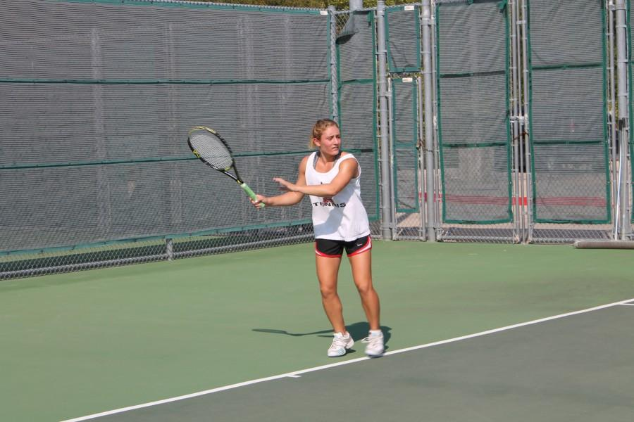 +Coppell%27s+most+dominant+force+senior+Abby+White+defeated+her+opponent+eight+sets+to+two%2C+taking+Coppell%27s+lead+to+five+to+two.+Photo+by+Mia.