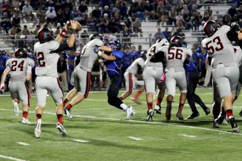 The Coppell Cowboys rammed their way through the Hebron Hawks defense en route to a runaway 29-3 Cowboy win, the team's first as a part of District 5-5A . Photo by Rinu Daniel.