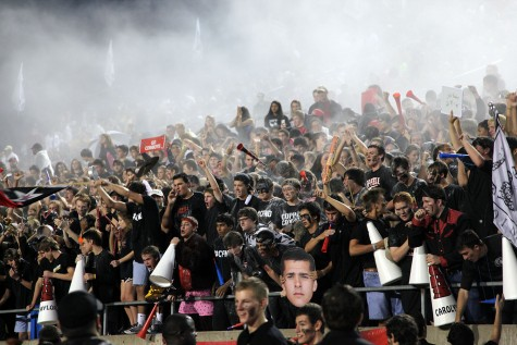 Passionate Coppell fans throw up baby powder at the beginning of the game to show their spirit, leaving a smoky effect. Photo by Rinu Daniel.