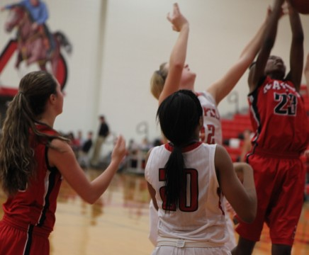 Fight to the finish leaves Cowgirls' with first district win