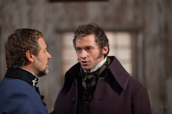 Characters Hugh Jackman and Russell Crowe act in Les Miserables. (MCT)