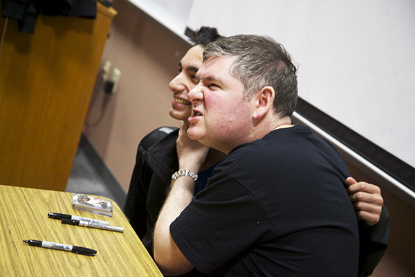 Jan. 30, After freshman Nick Jones' gets his book signed, he asks author Darren Shan if he could get his photo taken with the premier horror and fantasy fiction writer. Before the book signing, Shan spoke to both Coppell High School students and the Coppell ISD middle school students that gathered in the lecture hall to hear his presentation and ask questions on Wednesday. Shan is well known for writing The Saga of Darren Shan series as well as his Cirque Du Freak series. Photo by Rowan Khazendar.