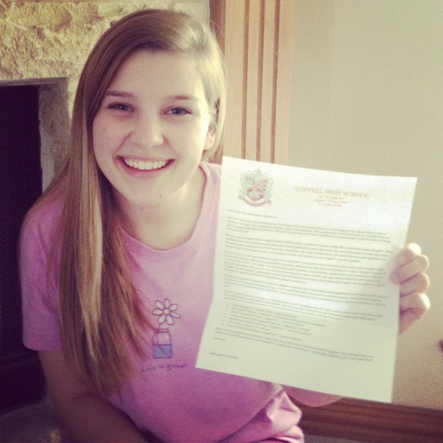 Junior Lilly Balsamo holds up her Red Jackets acceptance letter. The next class of Red Jackets will consist of 33 students. Photo courtesy Lilly Balsamo.