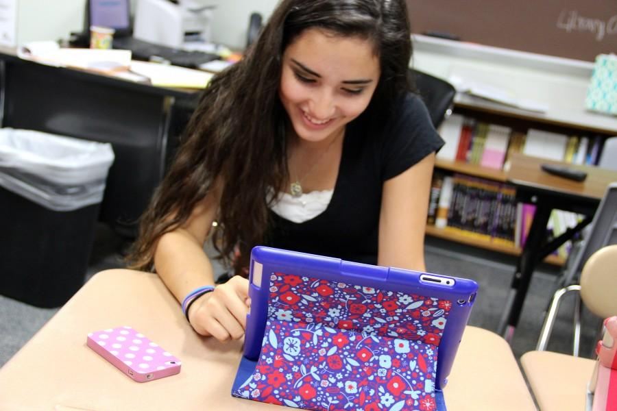 Sophomore Kassie Morlet uses her iPad to read in Joy Han's English class on Thursday.