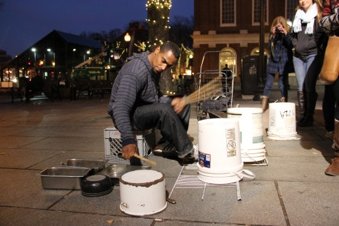 Jermaine Carter performs in front of Faneuil Hall in Boston on Thursday evening to entertain pedestrians. Thirty-one representatives from The Sidekick, Round-Up and KCBY are in the city attending the JEA/NSPA Fall National High School Journalism Convention. Photo by Sandy Iyer.