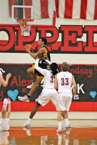 Cowboy basketball clutches win against Plano East