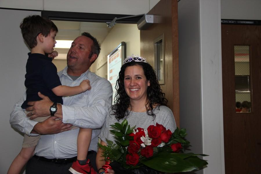Anatomy and Physiology teacher Jodie Deinhammer, pictured with her husband and son, was named 2013-2014 Coppell High School Teacher of the Year on Wednesday during fifth period.  Photo by Jena Seidemann