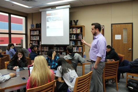 Mr. Caussey teaching his new AP World History-Blended class in the library. Photo by Sandy Iyer.