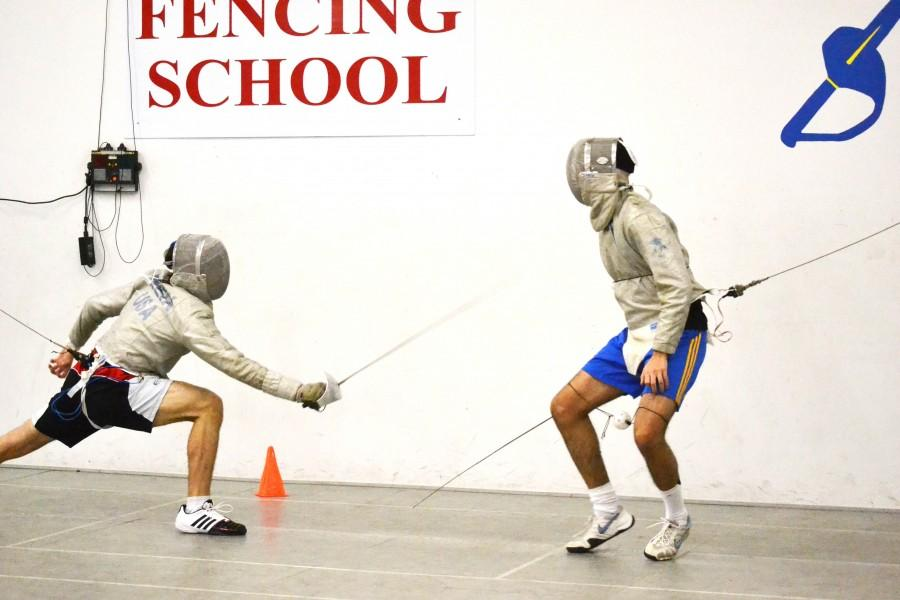Junior Derek Weix lunges toward a classmate during a practice match at the Husar Fencing School in Addison. Photo by Elizabeth Sims.