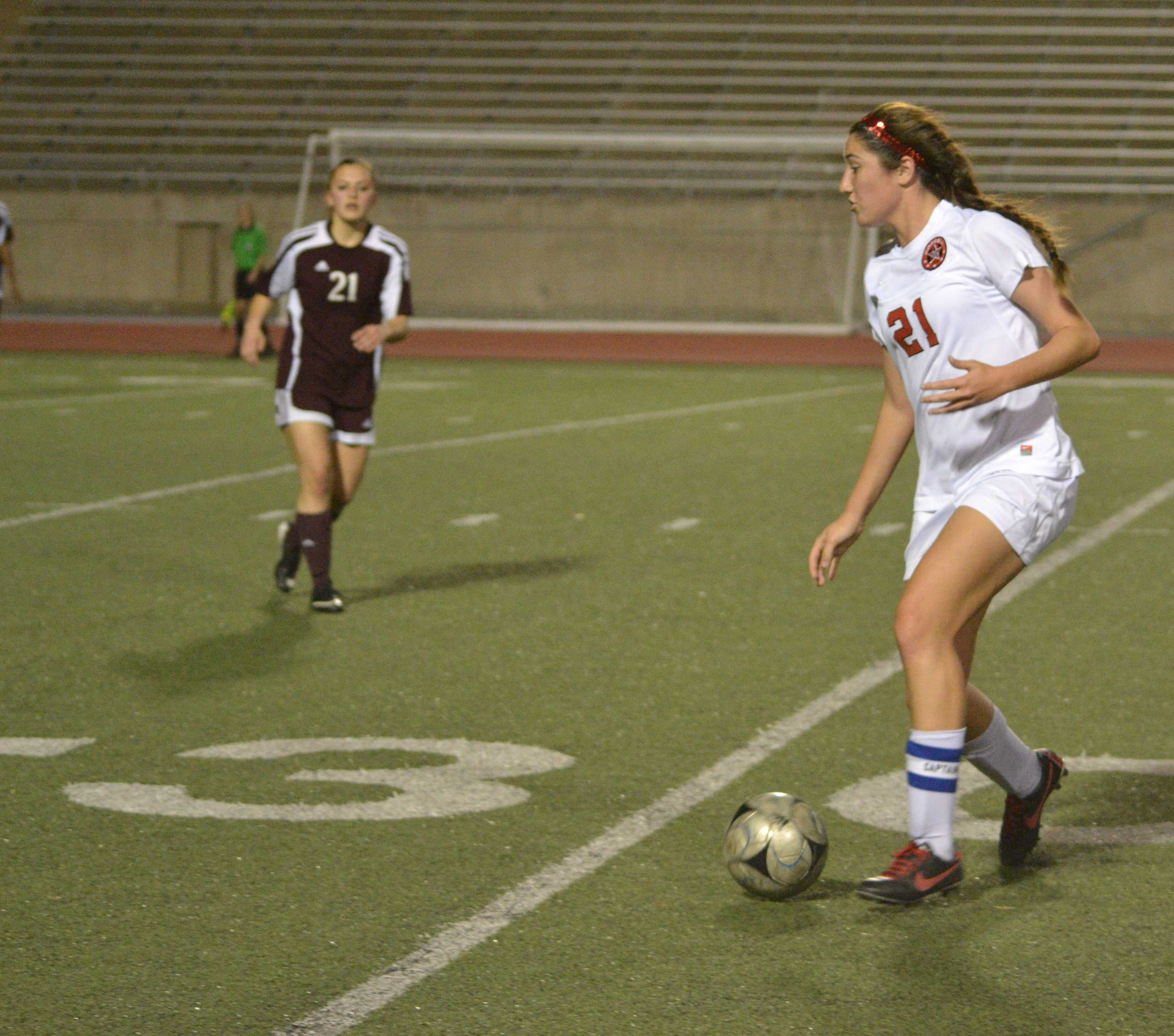 Junior forward, Sarah King, carefully drives the ball down field, before taking a shot on goal.