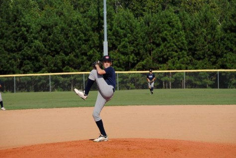 Sophomore Charles King winds-up to deliver a pitch during one of his travel team games