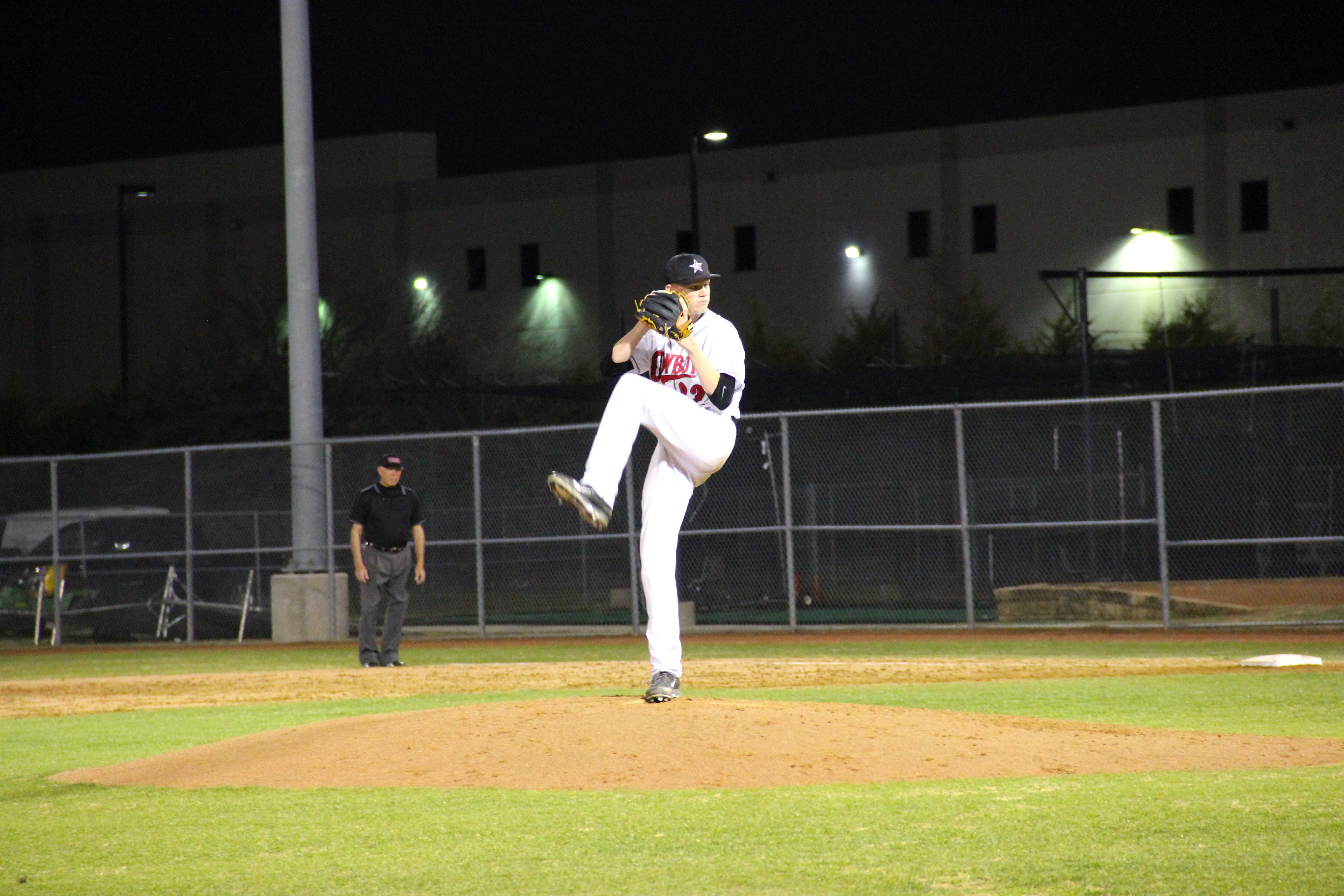 Junior righthanded pitcher Jensen Elliott gets ready to give an opposing batter the heat in Coppell's Mar. 18 matchup against the Flower Mound  Marcus Marauders. The Cowboys will take the rubber on Tuesday night against Denton Ryan. Photo by Alyssa Frost.