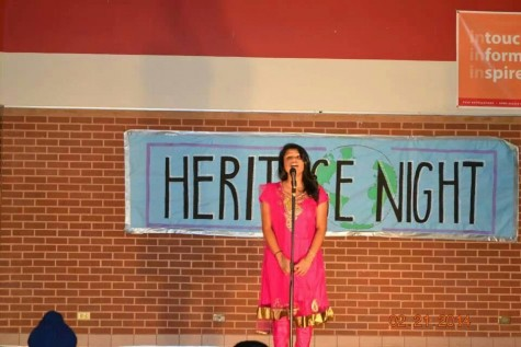 Junior Aleesha Johnson sings Turning Tables by Adele at Heritage Night in the Coppell High School Commons.