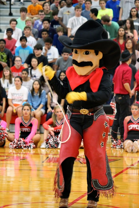 Cowboy Carl leads a skit to pump up the student body at the Rockwall pep rally on  Sept. 13, 2013.