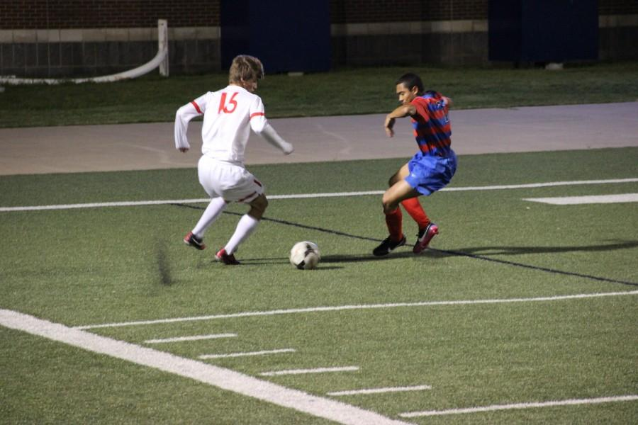 Senior+forward+Justin+Todd+maneuvers+the+ball+into+position+for+a+cross+as+a+Duncanville+defender+impedes+his+path+to+the+goal+in+Coppell%27s+UIL+Regional+Quarterfinal+match+against+the+Panthers+on+Apr.+8.+The+Cowboys+will+face+Flower+Mound+Marcus+in+the+Region+I+final+match+on+Saturday+afternoon+at+2+p.m.++Photo+by+Shannon+Wilkinson.