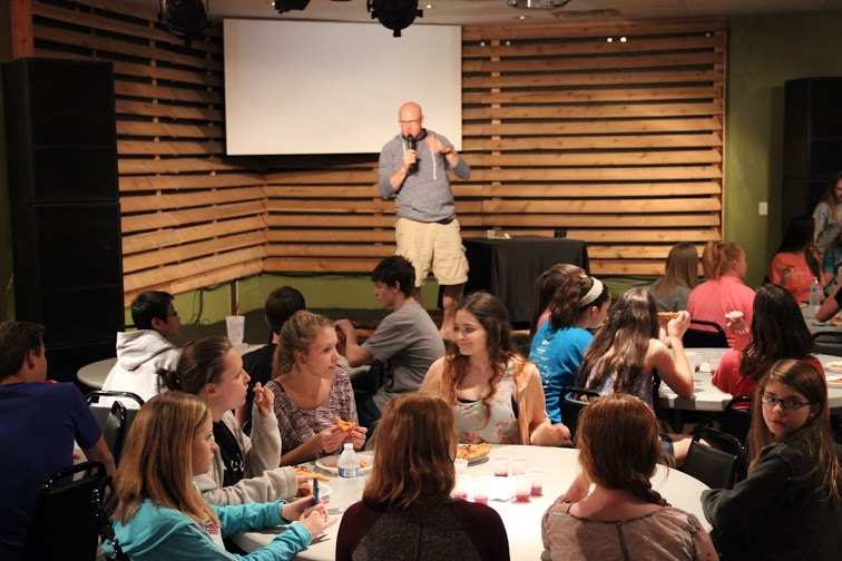 GracePoint student pastor Charley Hellmuth teaches GracePoint youth about the traditional Jewish Seder Meal during holy week; this was their first time to host the event. Photo by Jena Seidemann.