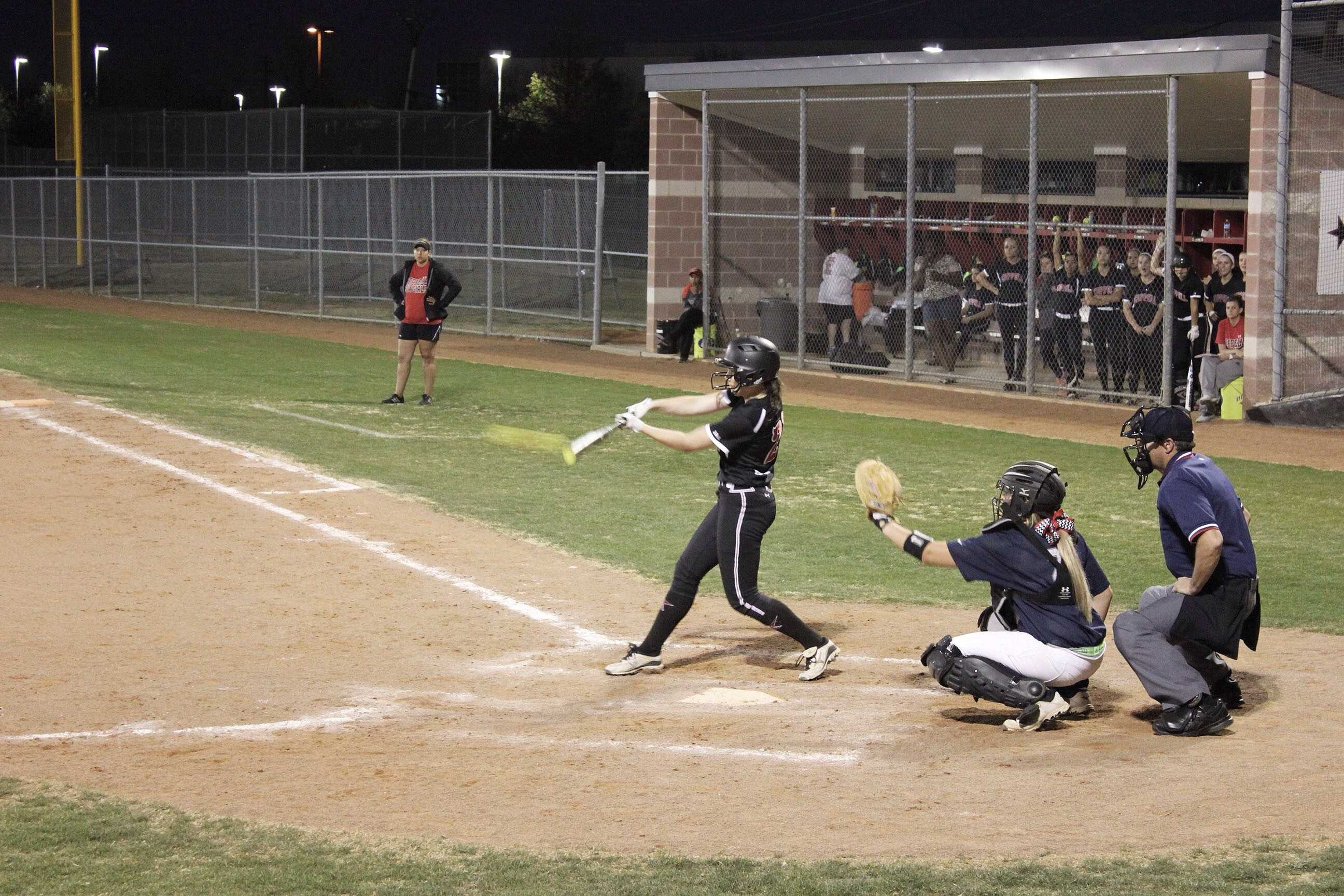 Sophomore outfielder Ali Gentry hits hard against rival Lewisville. Photo by Mark Slette.