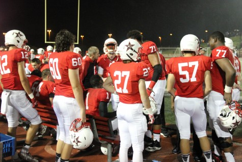The offense watches the Coppell defense against Eastern Christian. Coppell won the game 42-2 on Sept. 12. Photo by Mallorie Munoz