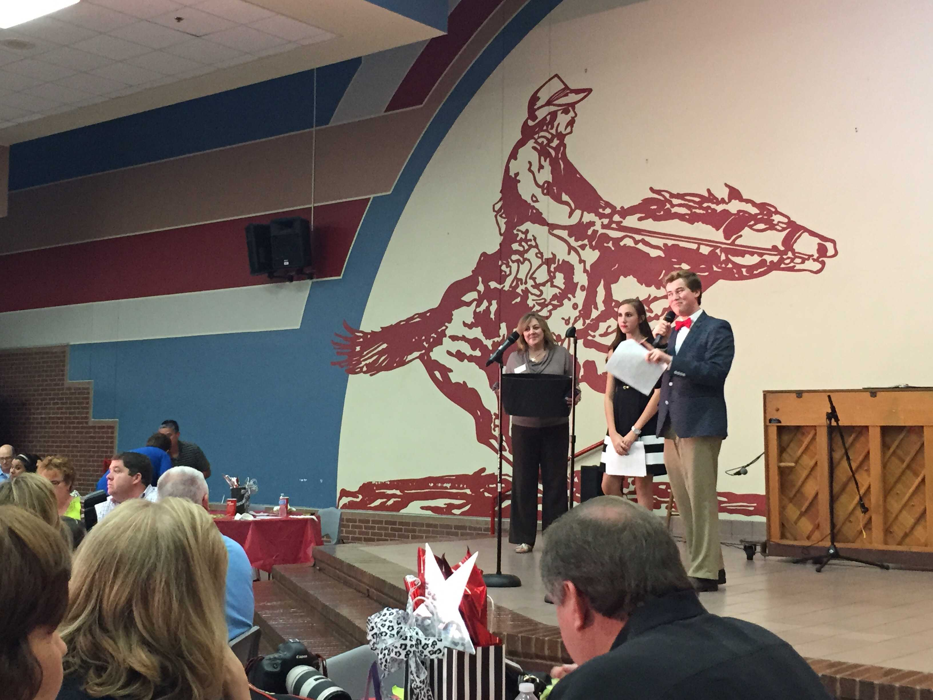 Past President Mary Miller, Vice President Sheridan Miller and President Cole Cloutier hosted theater's silent auction dinner and revue in the cafeteria.