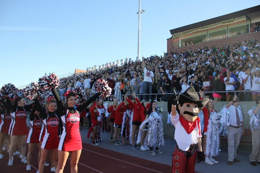 Coppell+High+School+students+raise+their+guns+while+singing+their+school+song+Oct.+17+at+the+homecoming+pep+rally+in+Buddy+Echols+Stadium.+Photo+by+Nicole+Messer.