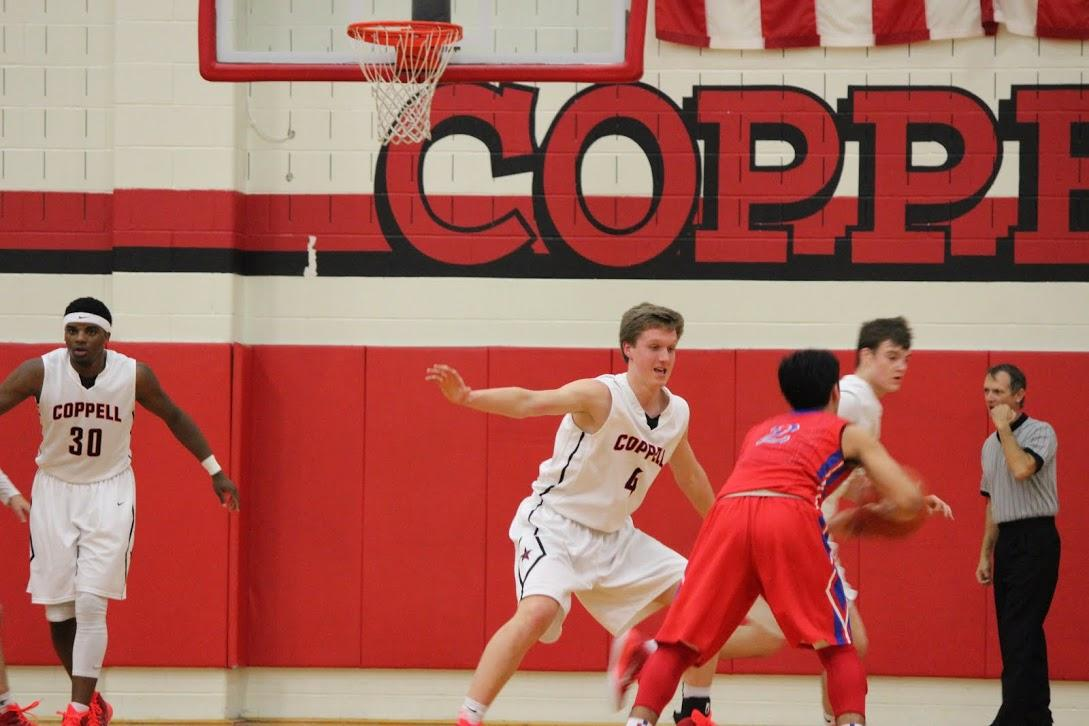 Sophomore Sam Marshall guards a Grapevine player in last night's game at Coppell High School. Marshall lead the team in scoring with 11 points. Photo by Kelly Monaghan.