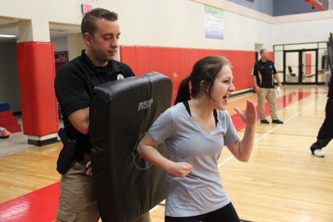 Senior girls learn to execute self-defense moves from Coppell Police Department