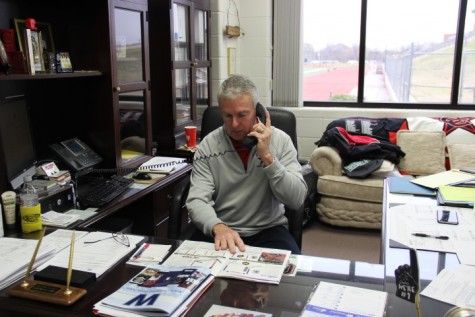 Athletics director John Crawford works in his office in the field house at Coppell High School on Feb. 20. Crawford has been at Coppell for 11 years. Photo by Kelly Monaghan.
