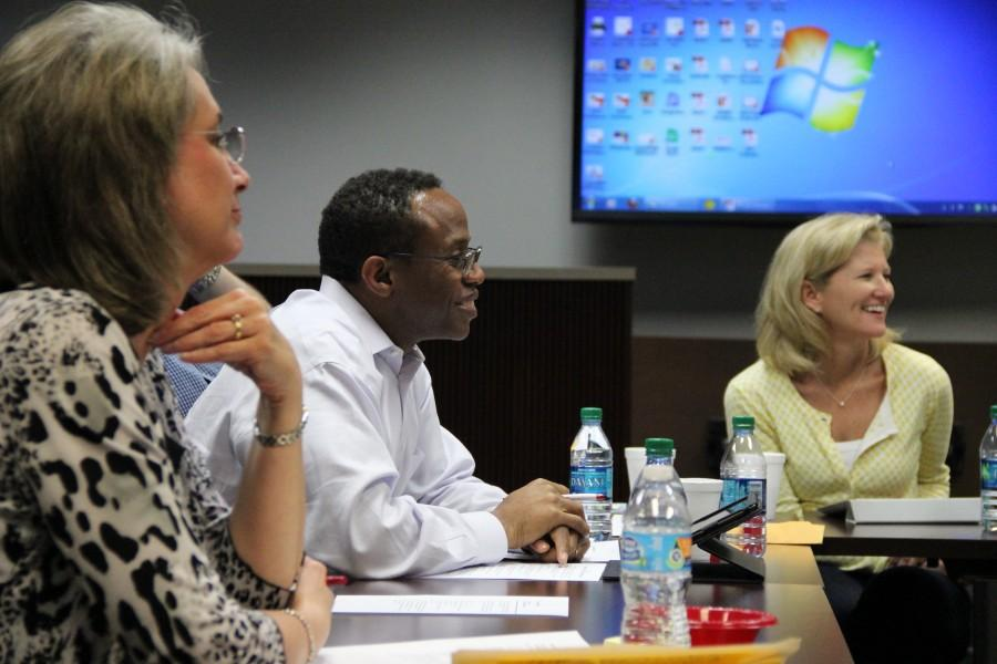 Board of Trustees president Anthony Hill (center) and vice president Susie Kemp (right) discuss policy changes at the special board meeting on April 13. Photo by Amanda Hair.