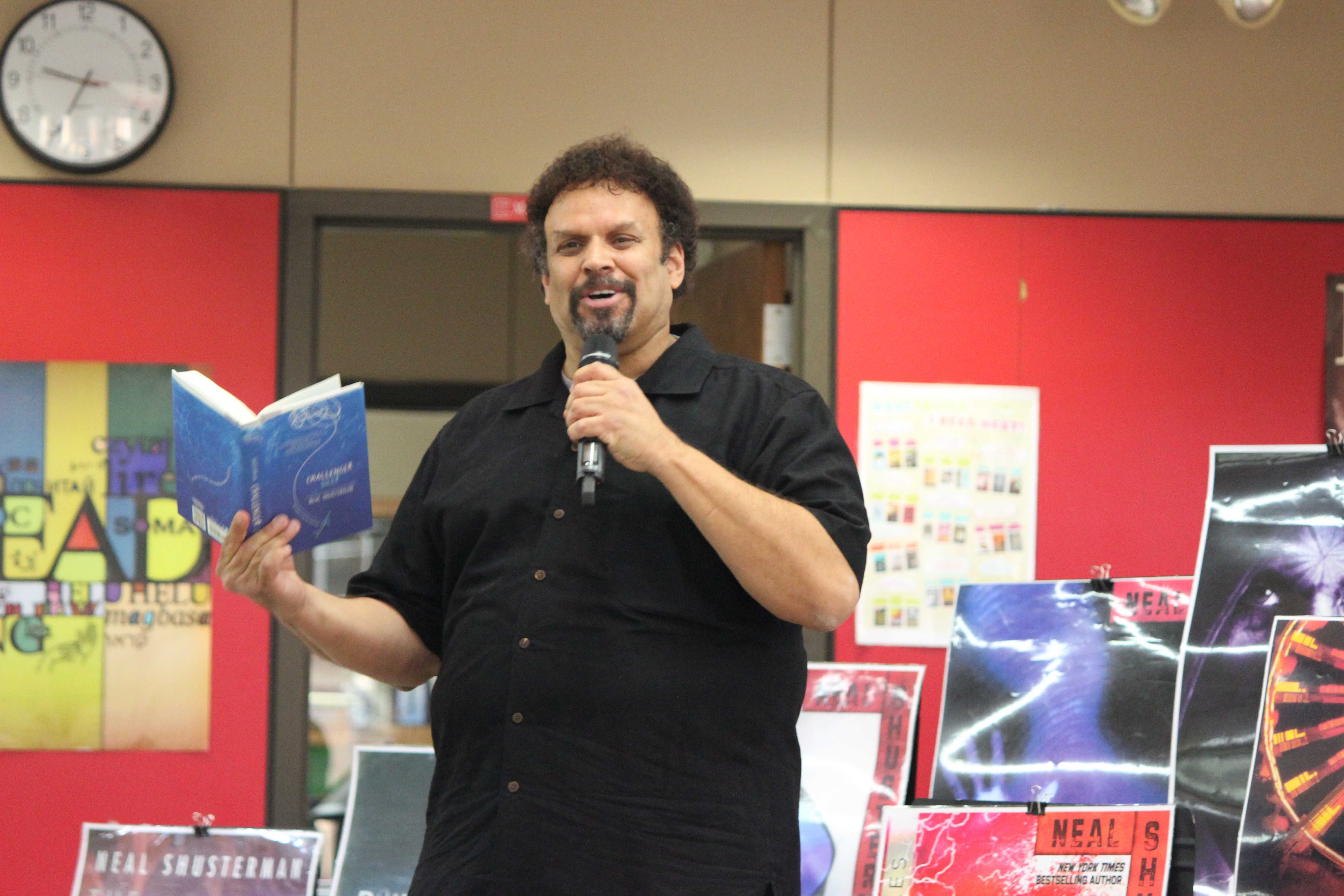 Author Neal Shusterman reads a paragraph of his new release