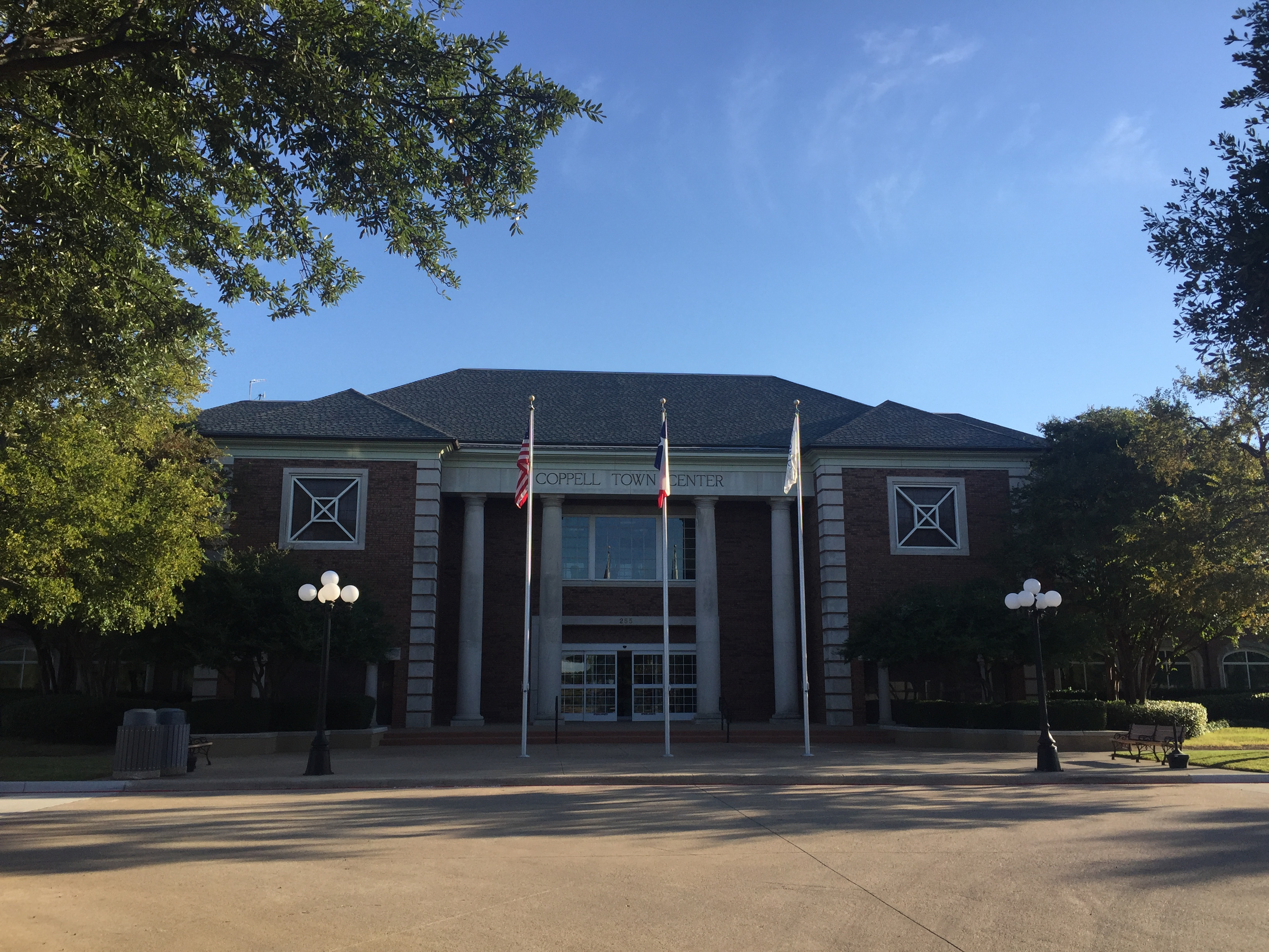 Coppell City Hall is located in Town Center next to the fire station and Coppell Community Garden. Many community events such as Music in the Plaza, Oak Fest, and the annual tree lighting are held in the Coppell Town Center Plaza behind City Hall. Photo by Kelly Monaghan.
