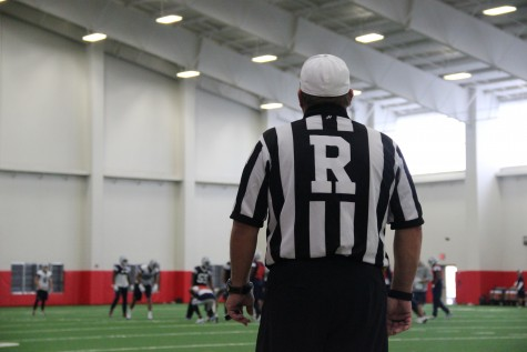 A referee looks on as the Dallas Cowboys practice in Coppell's field house. Photo by Mallorie Munoz.