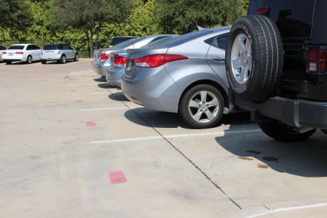Eighty additional senior parking spots were added into the student parking lot at Coppell High School on the morning of Sept. 30. These parking spots are marked with red stripes. Photo by Sruthi Boppuri.
