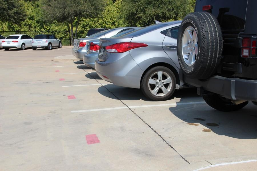 Eighty+additional+senior+parking+spots+were+added+into+the+student+parking+lot+at+Coppell+High+School+on+the+morning+of+Sept.+30.+These+parking+spots+are+marked+with+red+stripes.+Photo+by+Sruthi+Boppuri.+