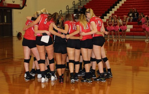 Cowgirls siege Lady Trojans in district volleyball
