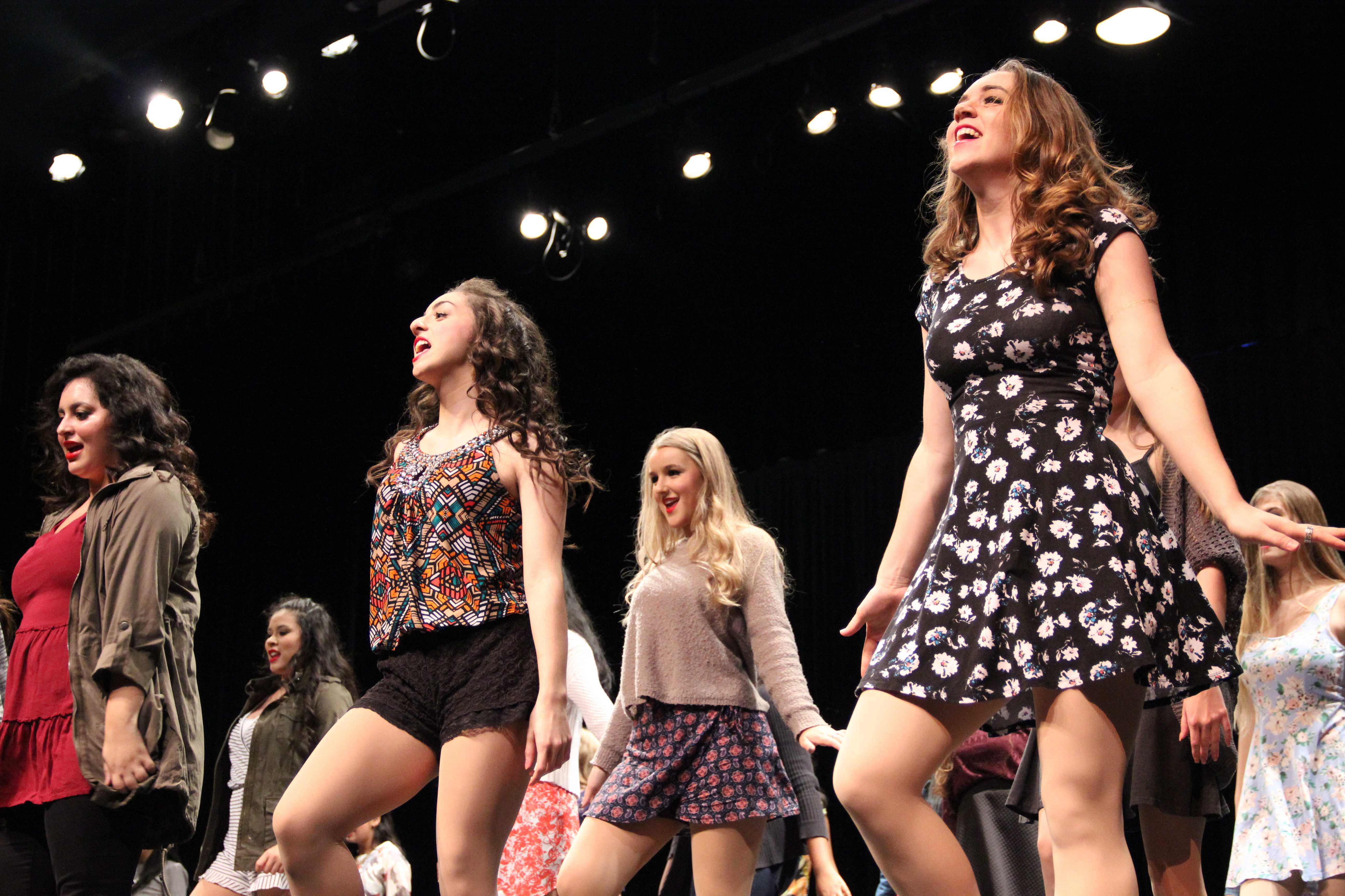 """The Coppell High School Respira Choir sings  """"Style"""" by Taylor Swift during Thursday night's performance in the CHS auditorium. During the intermission of the show, the audience was welcomed to the cafeteria to enjoy desserts. Photo by Amanda Hair."""