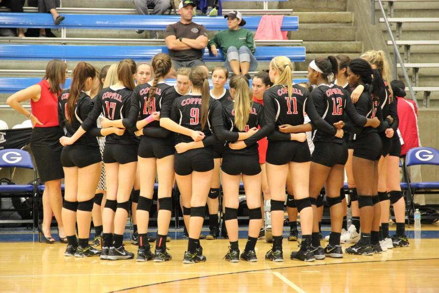 The+Cowgirls+celebrate+after+winning+the+final+point+of+the+third+set+of+Tuesday+night%E2%80%99s+game+at+the+Grand+Prairie+High+School+gymnasium.+Coppell+ended+the+night+with+a+3-0+victory+over+the+Mansfield+Tigers.+Photo+by+Amanda+Hair.+